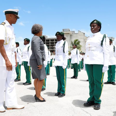 Deputy Permanent Secretary at the Ministry of National Security, Ms. Lisa Adderley inspecting the Rangers Guard during the Passing Out Parade Ceremony at the Defence Force's Coral Harbour Base on May 25th. Also shown are Commander Defence Force Commodore Tellis Bethel and Command Force Chief Oral Wood.