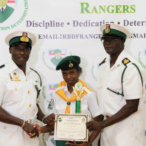 Kyiarjah Roker from St. George's High School. She received the overall Minister of National Security Award at the RBDF Rangers Passing out Parade ceremony in Grand Bahama on May 11, 2019. Also shown are: Lieutenant Commander Johnson, the commanding officer of the RBDF Freeport Base and Rangers Operations Senior Rate, Chief Petty Officer Pedro Bain.