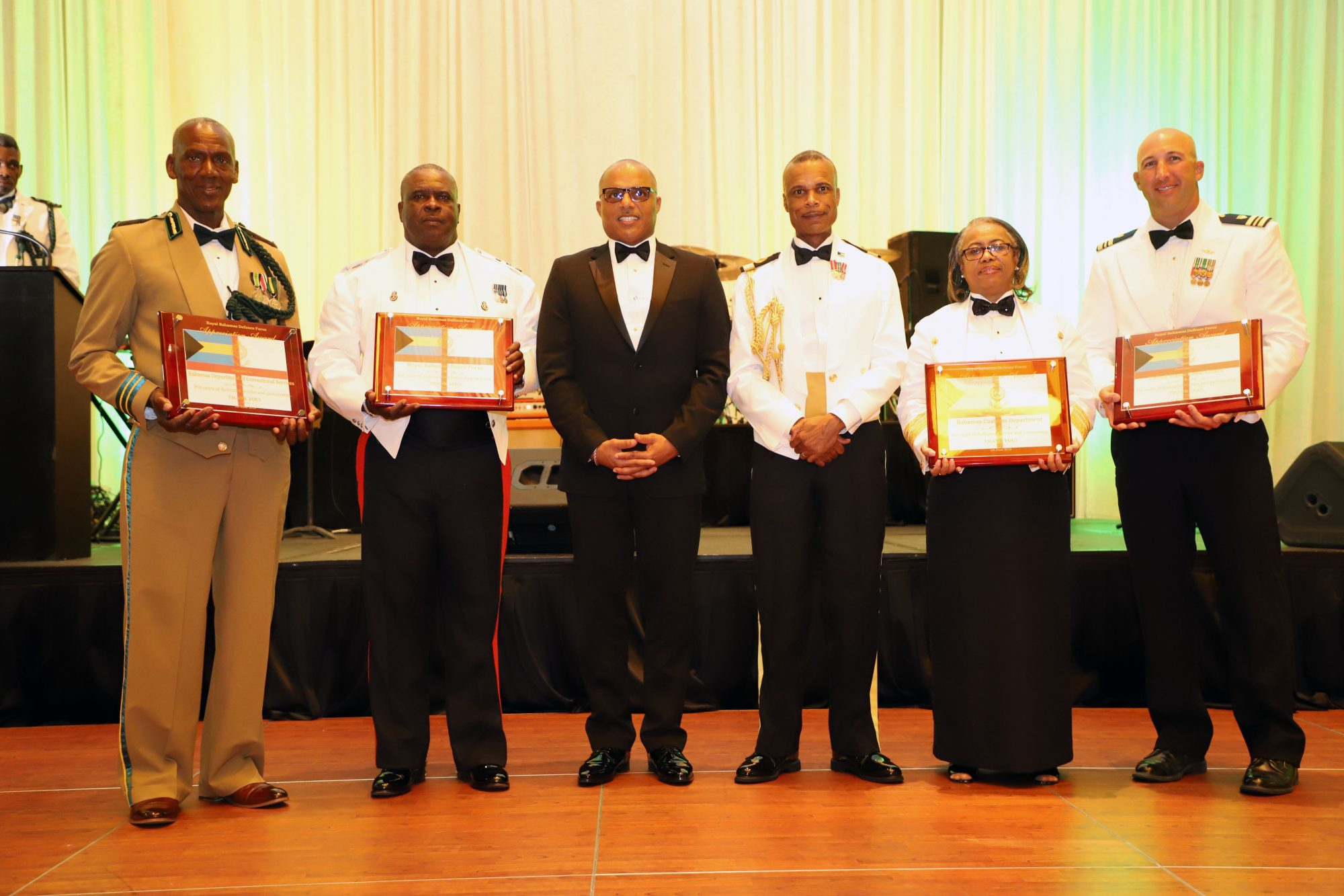 Partnering agencies receiving a token of appreciation from the Defence Force. From left: Bahamas Department of Correctional Services Commissioner Charles Murphy; Commissioner of Police Anthony Ferguson; the Minister of National Security the Honourable Marvin Dames; Commander Defence Force Commodore Tellis Bethel; Comptroller of Customs Dr. Geannine Moss and Lieutenant Commander Justin Matejka.
