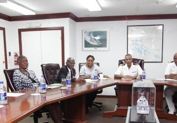 BRITISH LEGION CHAIRMAN PAYS COMMANDER DEFENCE FORCE A COURTESY CALL